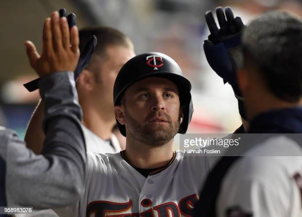 Brian Dozier of the Minnesota Twins celebrates scoring a run against the St Louis Cardinals during the sixth inning of the interleague game on May 15...
