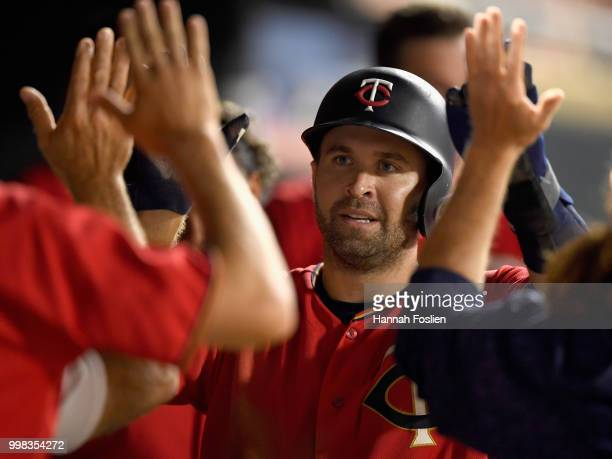 Brian Dozier of the Minnesota Twins celebrates scoring a run against the Tampa Bay Rays during the sixth inning of the game on July 13 2018 at Target...