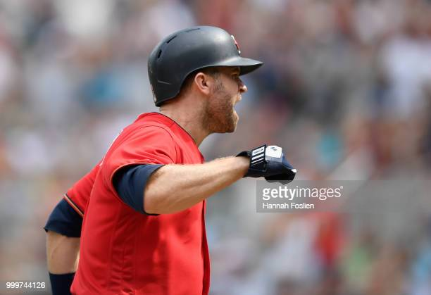 Brian Dozier of the Minnesota Twins celebrates scoring a run on a balk by Diego Castillo of the Tampa Bay Rays during the seventh inning of the game...