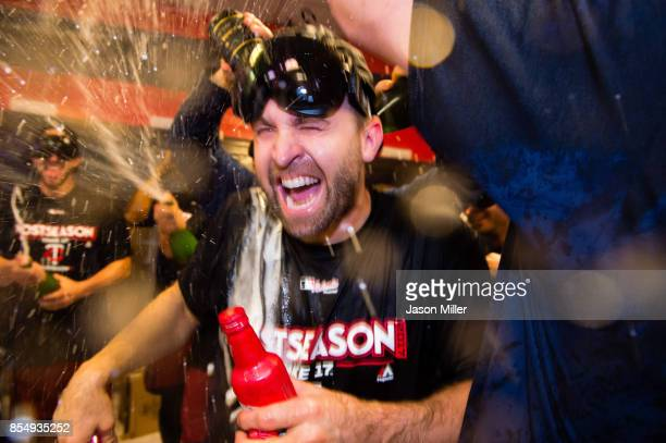Brian Dozier of the Minnesota Twins celebrates with his teammates after the Minnesota Twins clinched the second Wild Card spot of the American League...