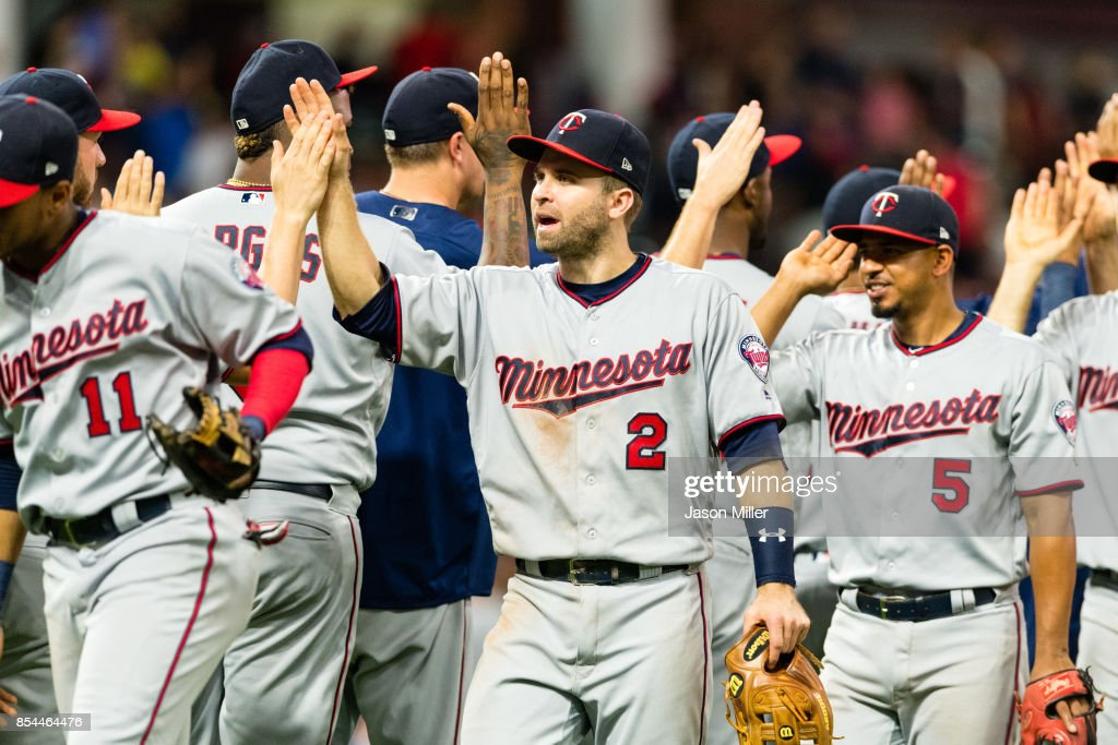 Brian Dozier #2 of the Minnesota Twins celebrates with teammates after the Twins defeated the Cleveland Indians at Progressive Field on September 26, 2017 in Cleveland, Ohio. The Twins defeated the Indians 8-6.