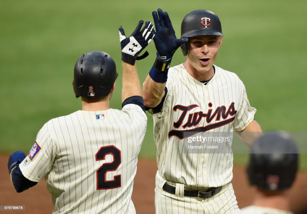 Brian Dozier #2 of the Minnesota Twins congratulates teammate Max Kepler #26 on a two-run home run against the Boston Red Sox during the fourth inning of the game on June 20, 2018 at Target Field in Minneapolis, Minnesota.