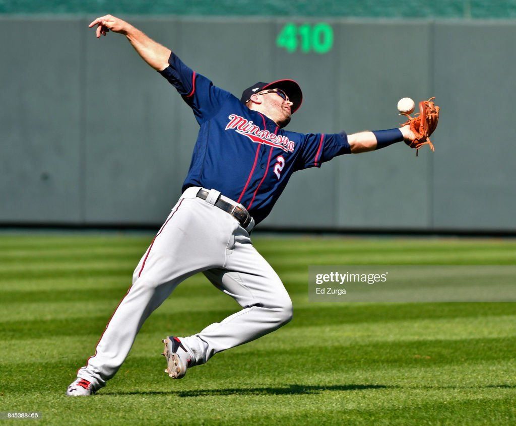 Brian Dozier #2 of the Minnesota Twins drops a ball hit by Salvador Perez #13 of the Kansas City Royals in the seventh inning at Kauffman Stadium on September 10, 2017 in Kansas City, Missouri.