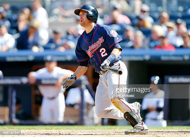 Brian Dozier of the Minnesota Twins follows through on a ninth inning two run double against the New York Yankees at Yankee Stadium on June 1, 2014...