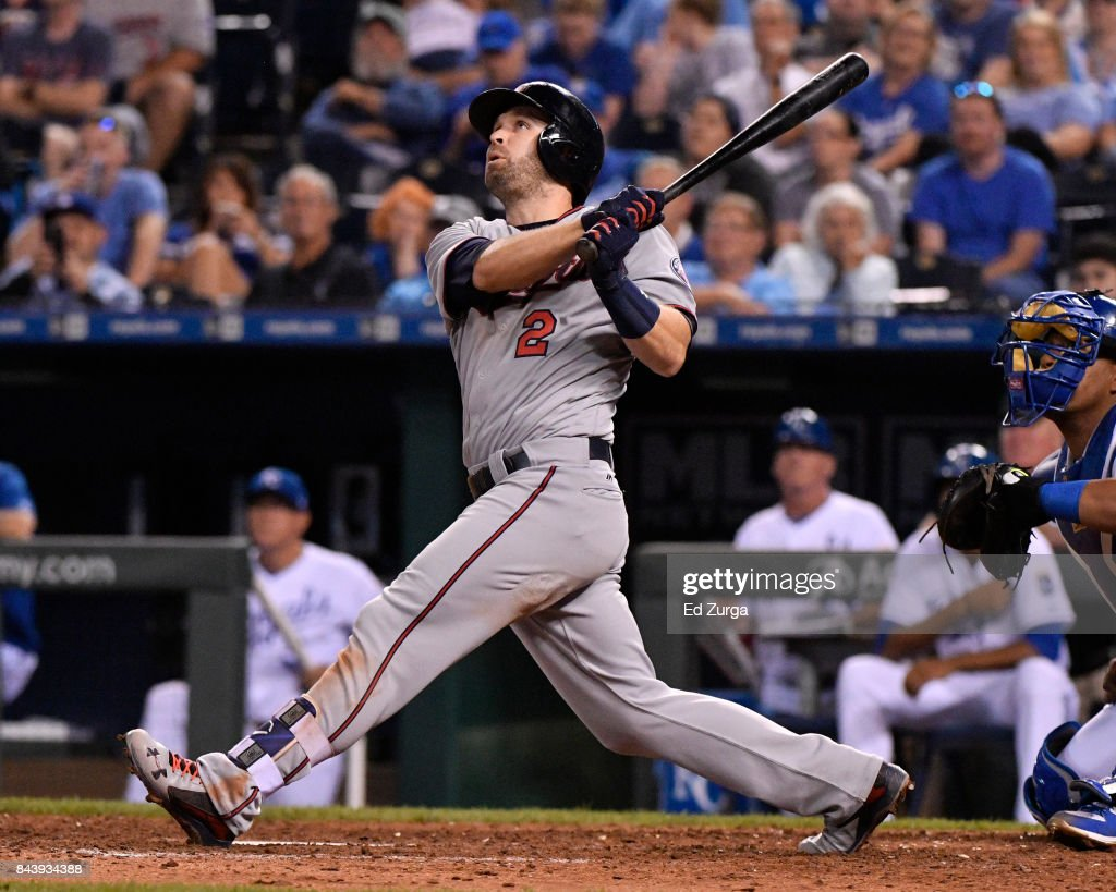 Brian Dozier #2 of the Minnesota Twins hits a RBI sacrifice fly in the ninth inning against the Kansas City Royals at Kauffman Stadium on September 7, 2017 in Kansas City, Missouri.