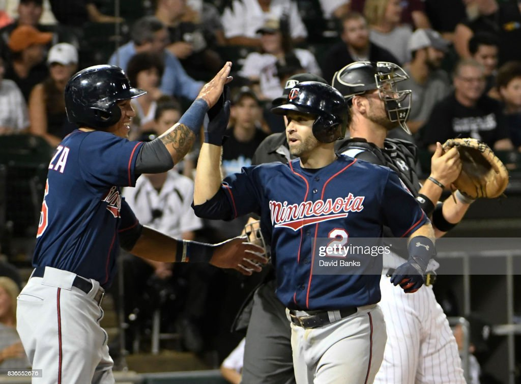 Brian Dozier #2 of the Minnesota Twins is greeted by Ehire Adrianza #16 of the Minnesota Twins after hitting a three-run homer against the Chicago White Sox during the second inning in game two of a doubleheader on August 21, 2017 at Guaranteed Rate Field in Chicago, Illinois.