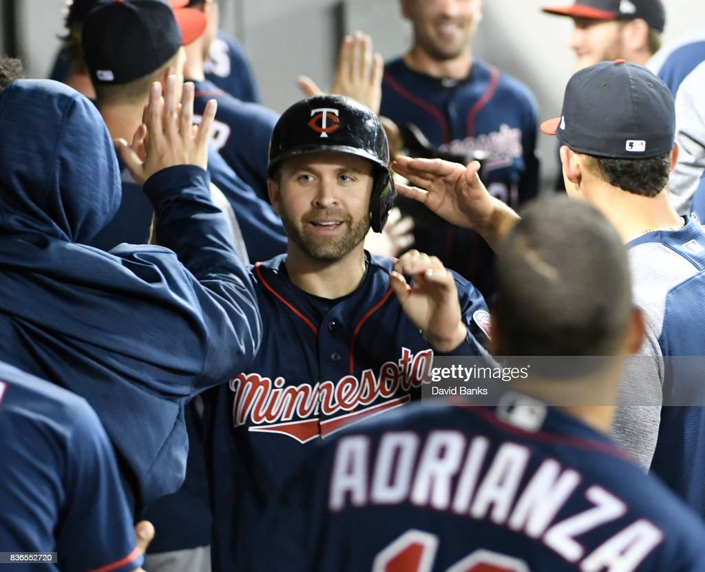 Brian Dozier #2 of the Minnesota Twins is greeted by teammates after hitting a three-run homer against the Chicago White Sox during the second inning in game two of a doubleheader on August 21, 2017 at Guaranteed Rate Field in Chicago, Illinois.
