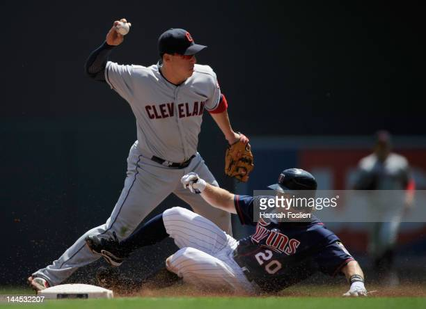 Brian Dozier of the Minnesota Twins is out at second base as Asdrubal Cabrera of the Cleveland Indians turns a double play during the second inning...