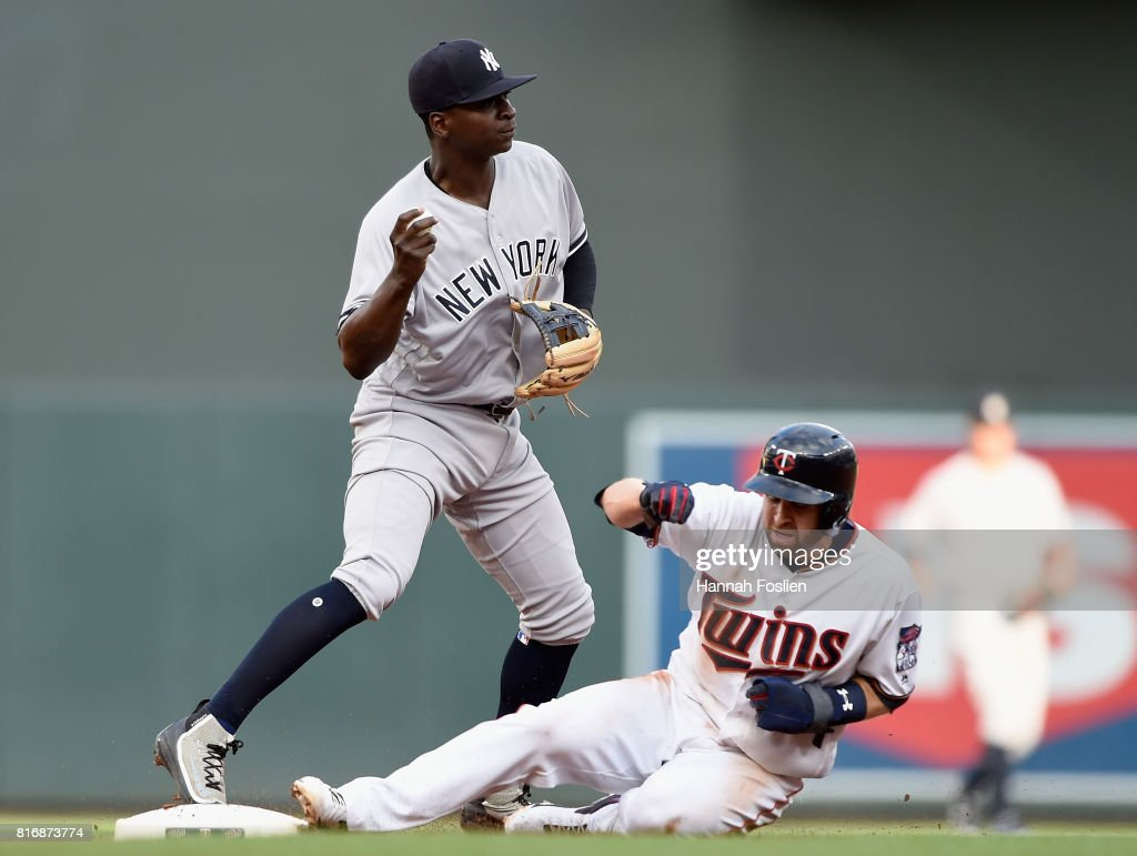 Brian Dozier #2 of the Minnesota Twins is out at second base as Didi Gregorius #18 of the New York Yankees is unable to turn a double play during the first inning of the game on July 17, 2017 at Target Field in Minneapolis, Minnesota.