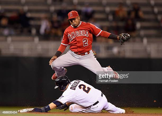 Brian Dozier of the Minnesota Twins is out at second base as Erick Aybar of the Los Angeles Angels of Anaheim jumps out off the way during the eighth...