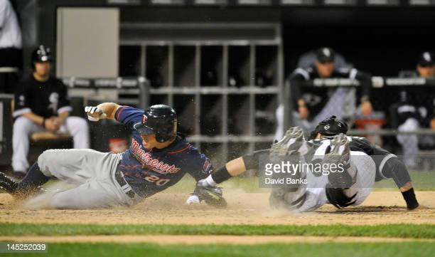 Brian Dozier of the Minnesota Twins is tagged out by AJ Pierzynski of the Chicago White Sox in the fifth inning on May 24 2012 at US Cellular Field...