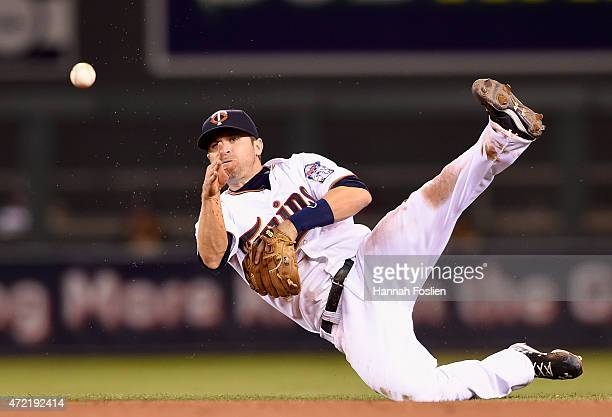 Brian Dozier of the Minnesota Twins makes a play to get out Ike Davis of the Oakland Athletics at first base during the fifth inning of the game on...
