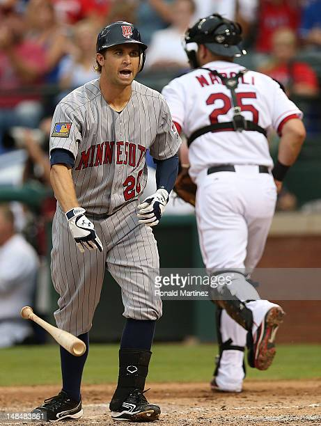Brian Dozier of the Minnesota Twins reacts after a strike out against the Texas Rangers at Rangers Ballpark in Arlington on July 7 2012 in Arlington...