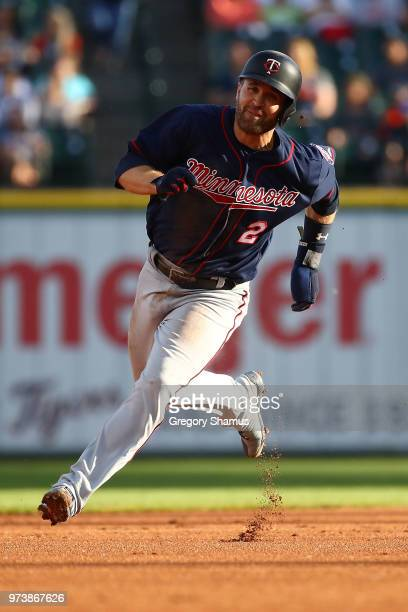 Brian Dozier of the Minnesota Twins rounds second base during the first inning while playing the Detroit Tigers at Comerica Park on June 13 2018 in...