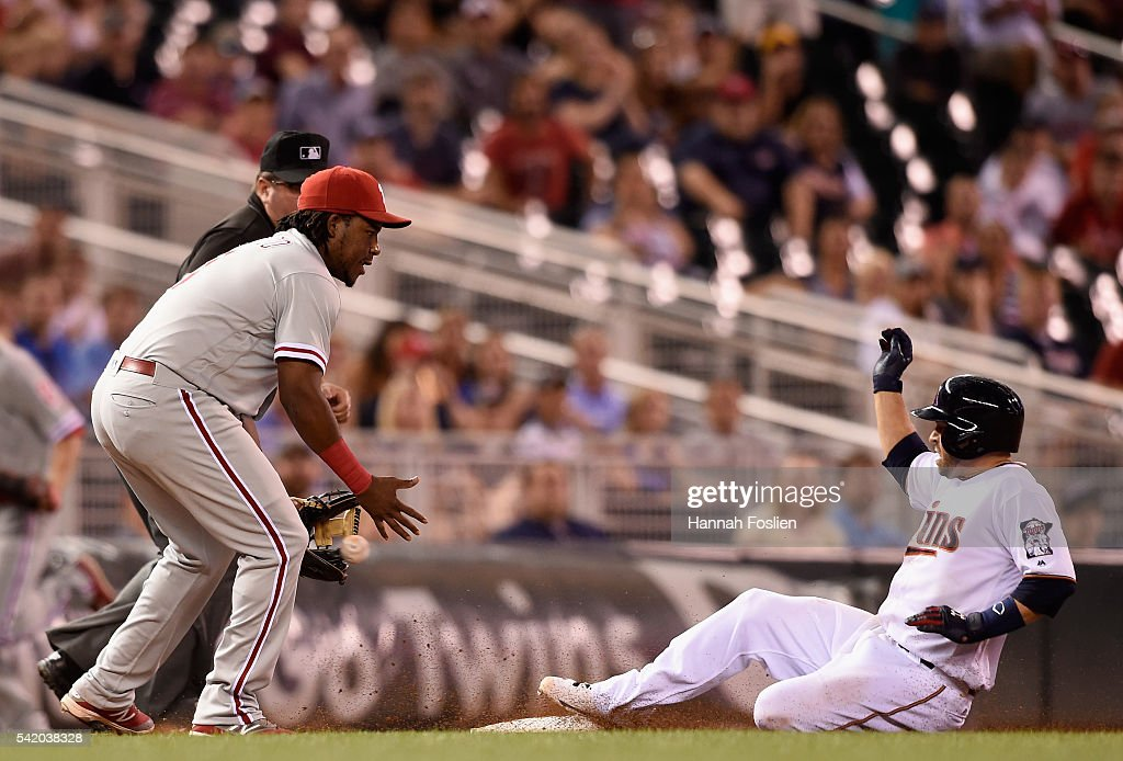 Brian Dozier #2 of the Minnesota Twins slides into third base safely with an RBI triple as Maikel Franco #7 of the Philadelphia Phillies fields the ball during the sixth inning of the game on June 21, 2016 at Target Field in Minneapolis, Minnesota. The Twins defeated the Phillies 14-10.