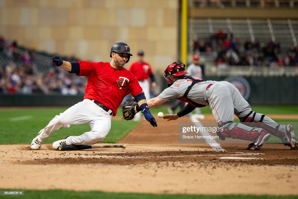 Brian Dozier #2 of the Minnesota Twins slides safely against the Cincinnati Reds on April 27, 2018 at Target Field in Minneapolis, Minnesota. The Reds defeated the Twins 15-9. (Photo by Brace Hemmelgarn/Minnesota Twins/Getty Images) Brian Dozier