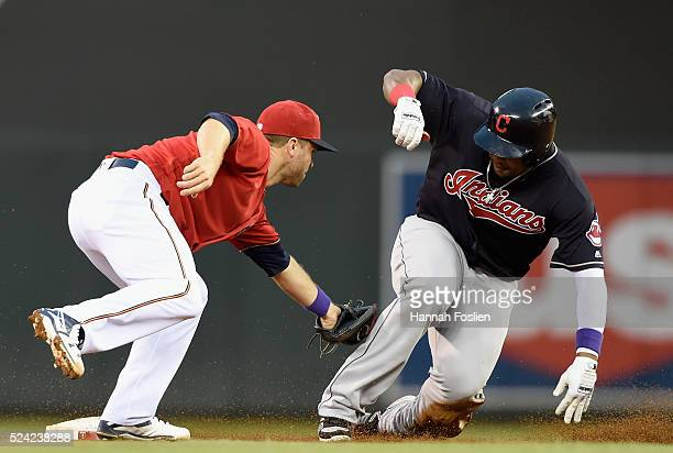 Brian Dozier of the Minnesota Twins tags out Marlon Byrd of the Cleveland Indians at second base during the second inning of the game on April 25,...