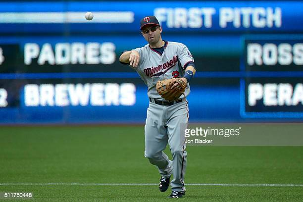 Brian Dozier of the Minnesota Twins throws the ball to first base during the game against the Toronto Blue Jays at the Rogers Centre on Monday August...