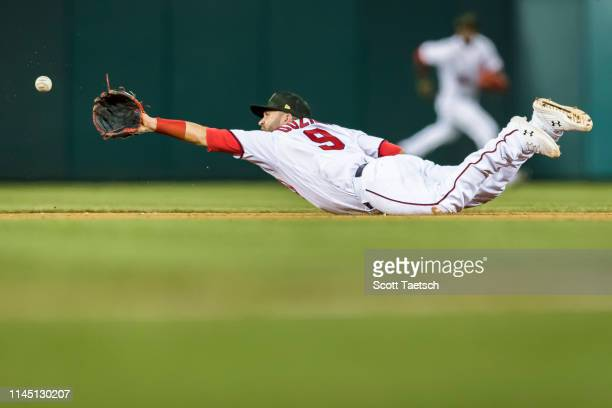 Brian Dozier of the Washington Nationals flips the ball to second after making a diving catch against the Chicago Cubs during the sixth inning at...