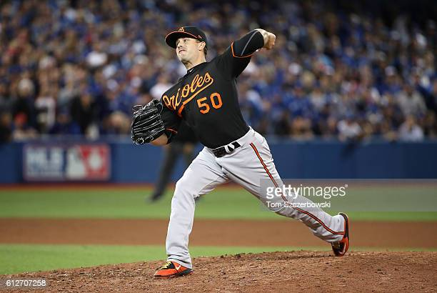 Brian Duensing of the Baltimore Orioles throws a pitch in the eleventh inning against the Toronto Blue Jays during the American League Wild Card game...