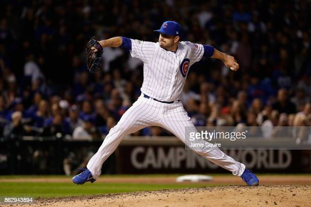 Brian Duensing of the Chicago Cubs pitches in the seventh inning against the Los Angeles Dodgers during game four of the National League Championship...