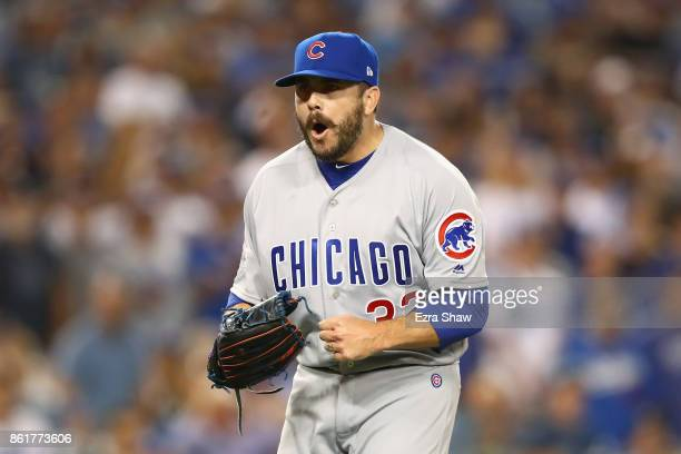 Brian Duensing of the Chicago Cubs reacts after a double play in the eighth inning during Game Two of the National League Championship Series against...