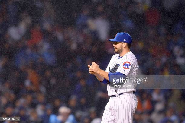 Brian Duensing of the Chicago Cubs stands on the mound in the eighth inning during game four of the National League Division Series against the...