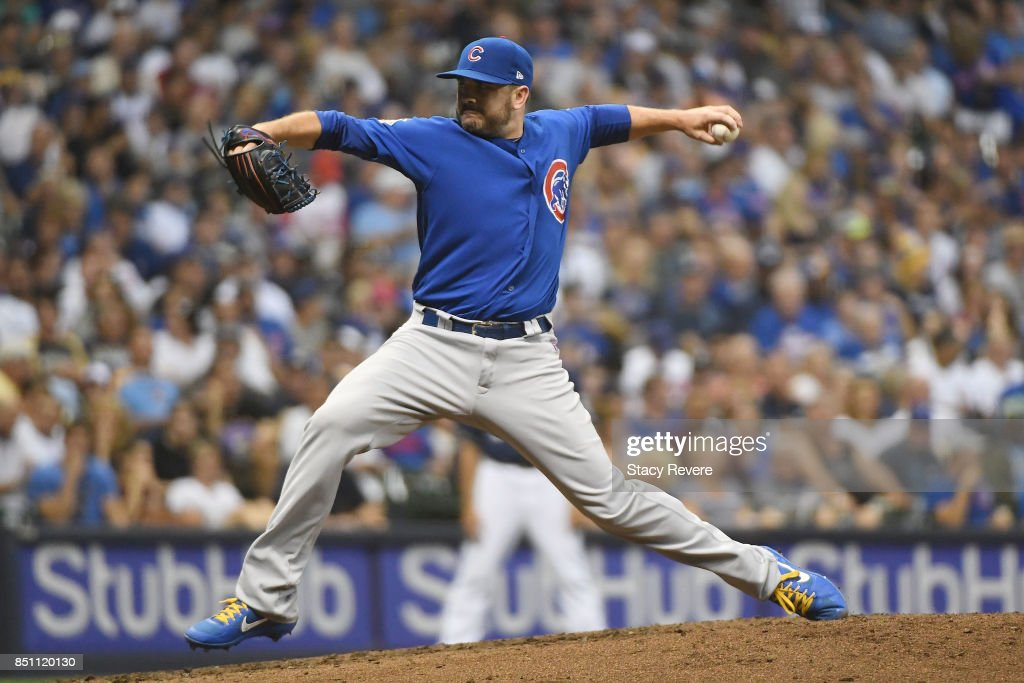 Brian Duensing #32 of the Chicago Cubs throws a pitch during the seventh inning of a game against the Milwaukee Brewers at Miller Park on September 21, 2017 in Milwaukee, Wisconsin.