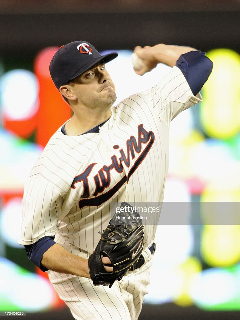 Brian Duensing #52 of the Minnesota Twins delivers a pitch against the Philadelphia Phillies during the eighth inning of the game on June 12, 2013 at Target Field in Minneapolis, Minnesota. The Twins defeated the Phillies 4-3.