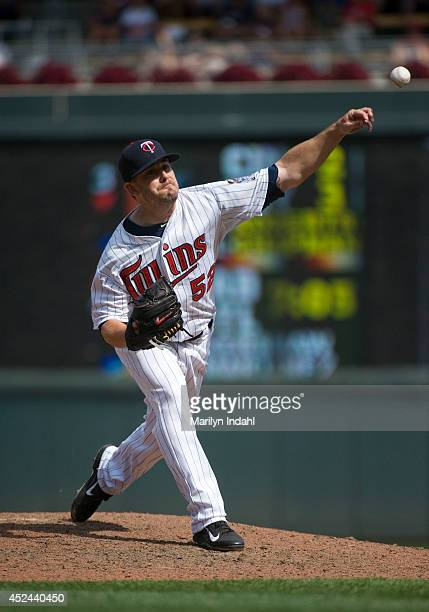 Brian Duensing of the Minnesota Twins delivers a pitch during the eighth inning against the Tampa Bay Rays at Target Field on July 20 2014 in...