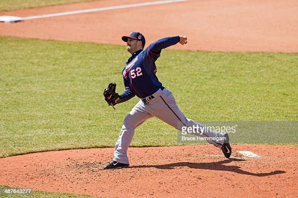 Brian Duensing of the Minnesota Twins pitches against the Cleveland Indians on April 5 2014 at Progressive Field in Cleveland Ohio The Twins defeated...