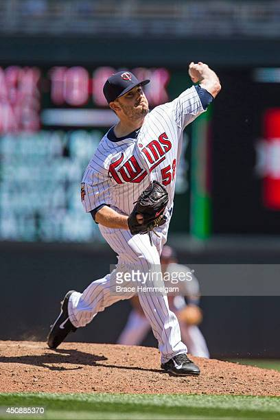 Brian Duensing of the Minnesota Twins pitches against the Texas Rangers on May 29 2014 at Target Field in Minneapolis Minnesota The Rangers defeated...