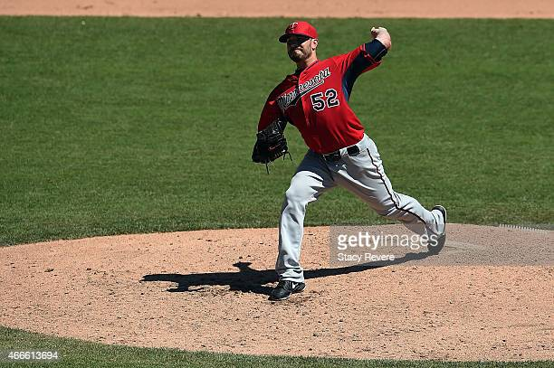 Brian Duensing of the Minnesota Twins throws a pitch during the sixth inning of a spring training game against the Baltimore Orioles at Ed Smith...