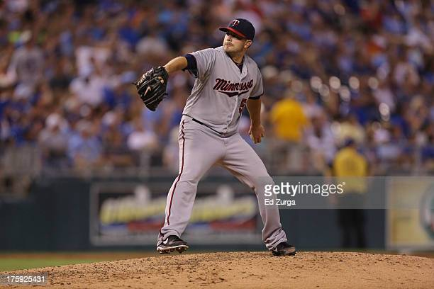 Brian Duensing of the Minnesota Twins throws against against the Kansas City Royals at Kauffman Stadium August 2013 in Kansas City Missouri