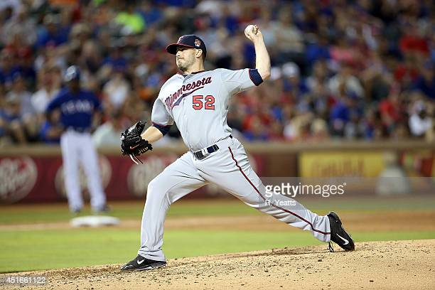 Brian Duensing of the Minnesota Twins throws in the seventh inning against the Texas Rangers at Globe Life Park in Arlington on June 27 2014 in...