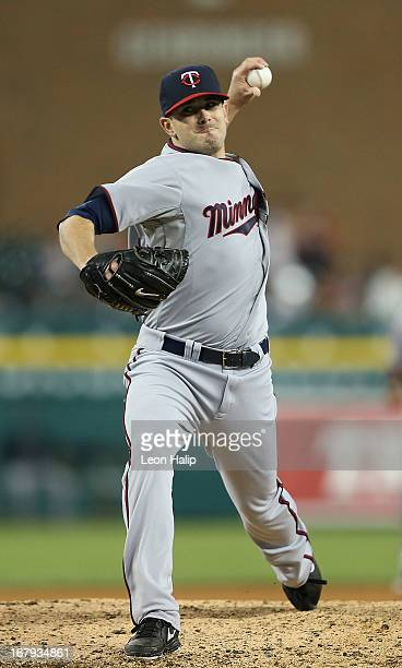 Brian Duensing of the Minnesota Twins watches the action from the dugout during the sixth inning of the game against the Detroit TIgers at Comerica...