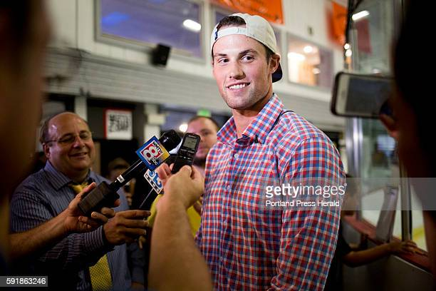 Brian Dumoulin being interviewed by media in front of the ice rink at Biddeford Arena where he grew up playing hockey Dumoulin is the first Maine...