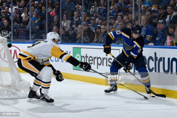 Brian Dumoulin of the Pittsburgh Penguins and Alexander Steen of the St Louis Blues battle at Scottrade Center on February 11 2018 in St Louis...