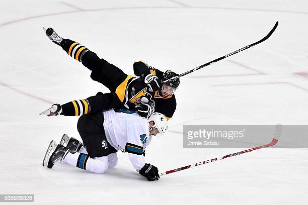 Brian Dumoulin of the Pittsburgh Penguins and Tomas Hertl of the San Jose Sharks fall on the ice during the second period in Game One of the 2016 NHL...