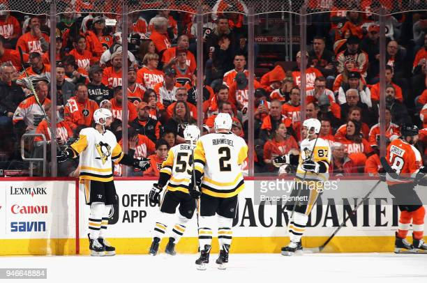 Brian Dumoulin of the Pittsburgh Penguins celebrates his goal against the Philadelphia Flyers at 653 of the second period in Game Three of the...