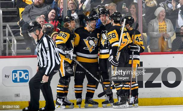 Brian Dumoulin of the Pittsburgh Penguins celebrates his second period goal against the Minnesota Wild at PPG Paints Arena on January 25 2018 in...