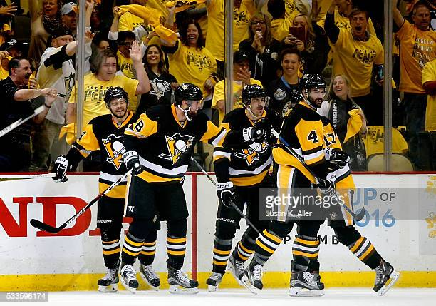 Brian Dumoulin of the Pittsburgh Penguins celebrates with his teammates after scoring a goal against Andrei Vasilevskiy of the Tampa Bay Lightning...