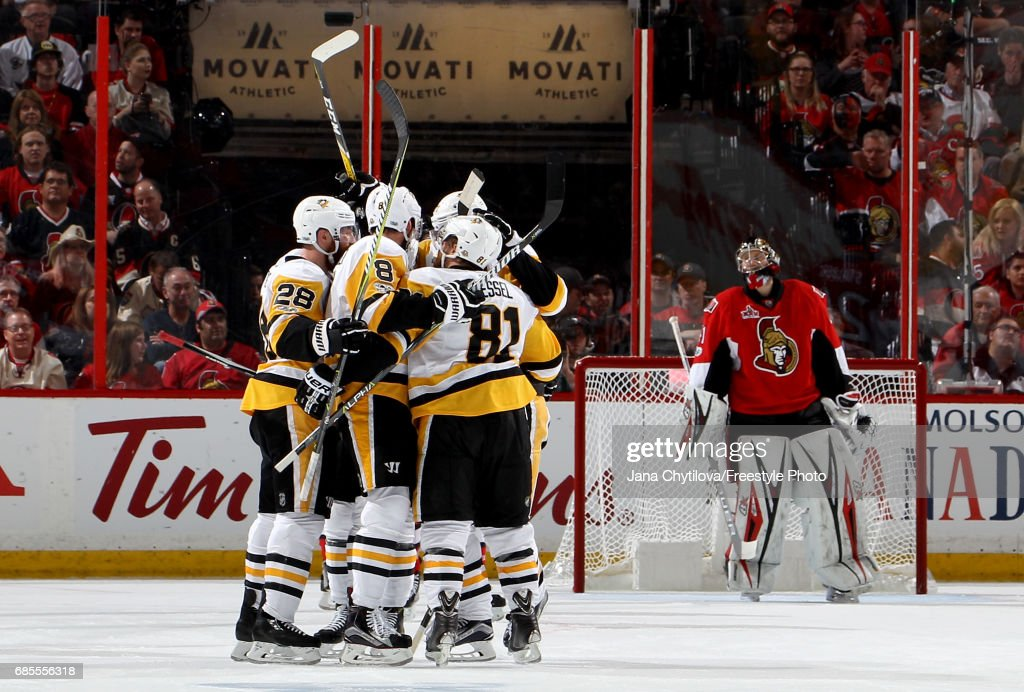 Brian Dumoulin #8 of the Pittsburgh Penguins celebrates with his teammates after scoring a goal against Craig Anderson #41 of the Ottawa Senators during the second period in Game Four of the Eastern Conference Final during the 2017 NHL Stanley Cup Playoffs at Canadian Tire Centre on May 19, 2017 in Ottawa, Canada.