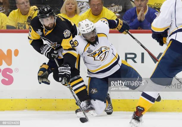 Brian Dumoulin of the Pittsburgh Penguins collides with PK Subban of the Nashville Predators during the second period of Game Two of the 2017 NHL...