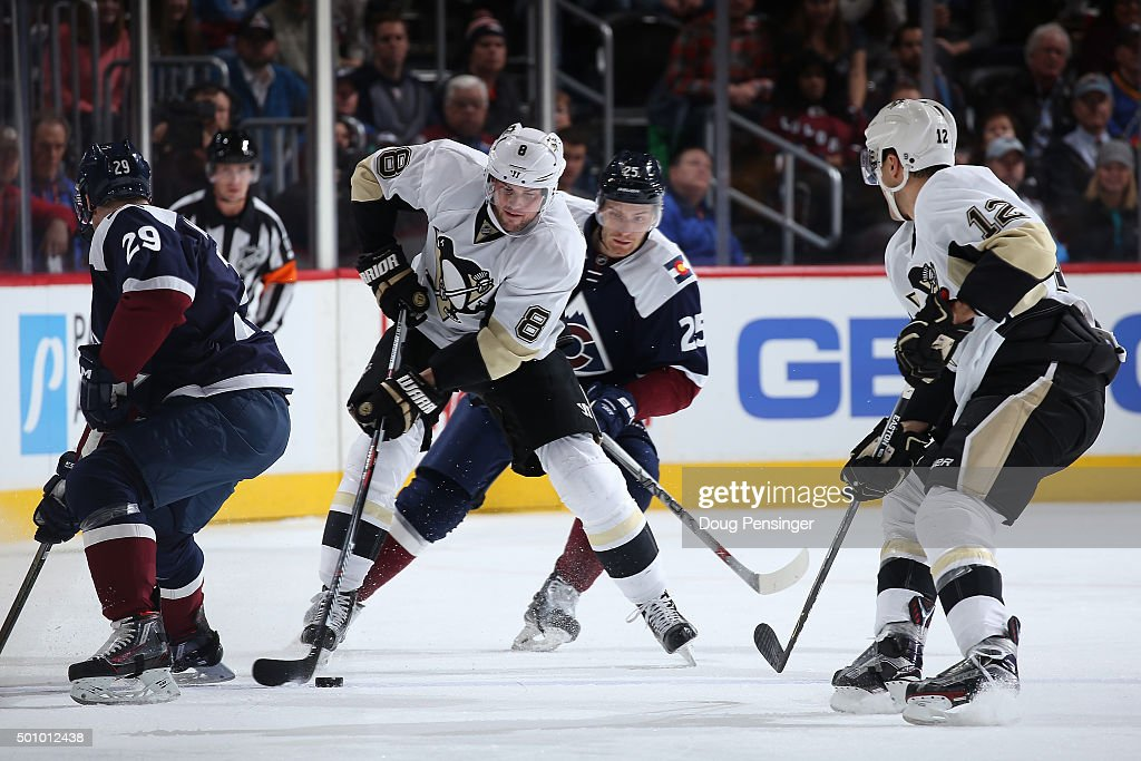 Brian Dumoulin #8 of the Pittsburgh Penguins controls the puck against the Colorado Avalanche at Pepsi Center on December 9, 2015 in Denver, Colorado. The Penguins defeated the Avalanche 4-2.