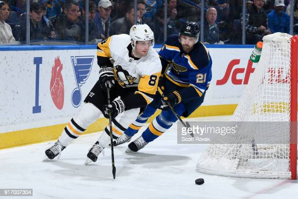 Brian Dumoulin of the Pittsburgh Penguins controls the puck as Patrik Berglund of the St Louis Blues defends at Scottrade Center on February 11 2018...