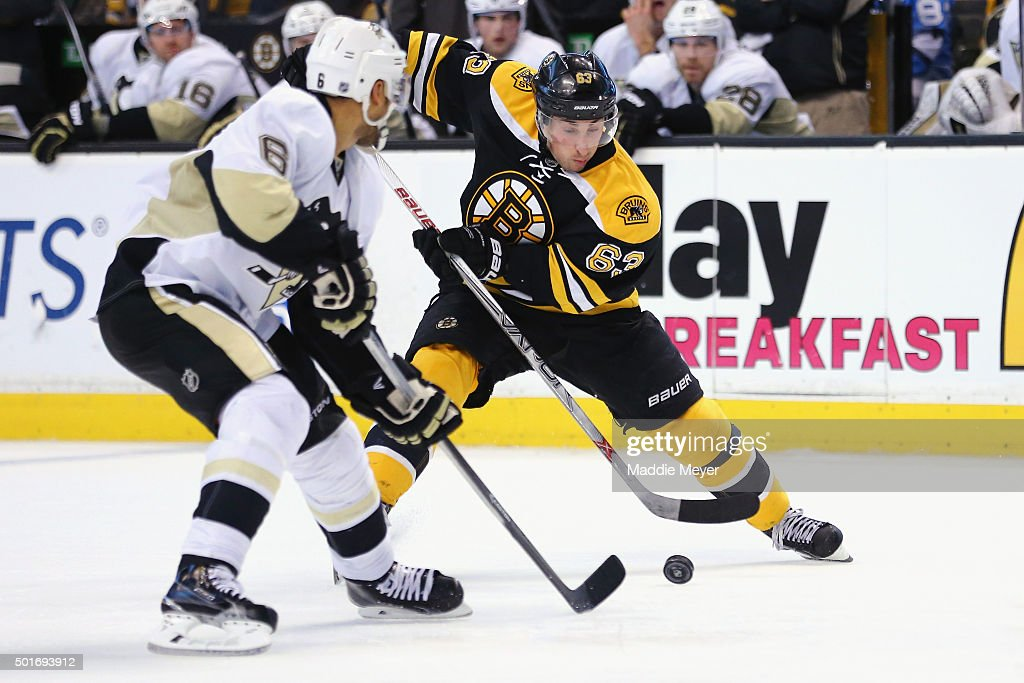 Brian Dumoulin #8 of the Pittsburgh Penguins defends Brad Marchand #63 of the Boston Bruins during the third period at TD Garden on December 16, 2015 in Boston, Massachusetts. The Bruins defeat the Penguins 3-0.