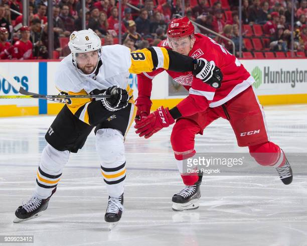 Brian Dumoulin of the Pittsburgh Penguins follows the play in front of Anthony Mantha of the Detroit Red Wings during an NHL game at Little Caesars...