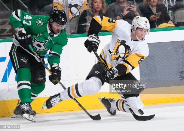 Brian Dumoulin of the Pittsburgh Penguins handles the puck against the Dallas Stars at the American Airlines Center on February 9 2018 in Dallas Texas