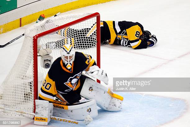 Brian Dumoulin of the Pittsburgh Penguins lays on the ice in pain during the third period against the Tampa Bay Lightning in Game One of the Eastern...